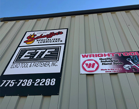 Company Signs On Exterior of Building